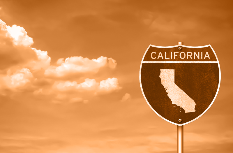 interstate road sign featuring California map