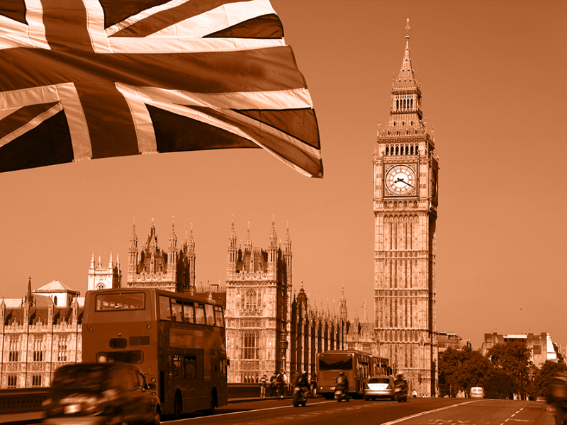 Big Ben tower with union jack flag in foreground