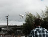 Documentary film crew using their new aerial drone for a scene.
