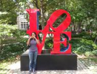 """In front of the iconic """"LOVE"""" statue at the University of Pennsylvania campus."""