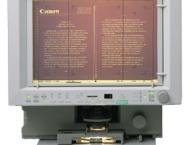 You can then ask a librarian to bring you the microfilm of that particular month's People's Daily and read it on a special microfilm scanner/projector, which may look like this: